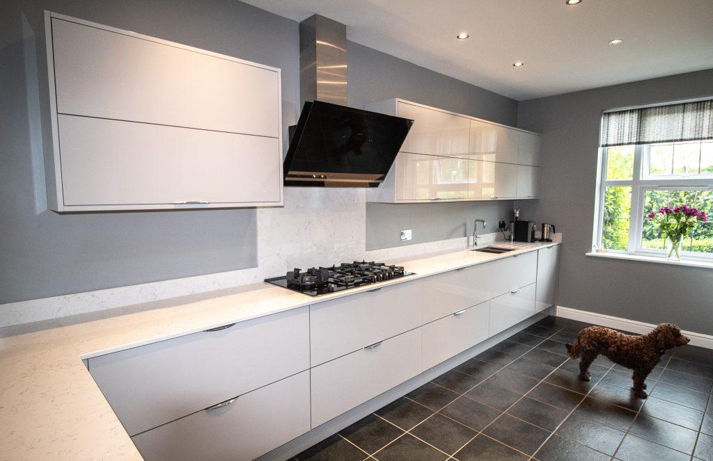 Gloss Finish Kitchen in Light Grey. Supplied and Installed by Noble Kitchens, Coventry and Warwickshire